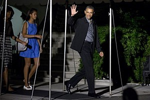 President Barack Obama is followed by first lady Michelle Obama and their daughter Malia