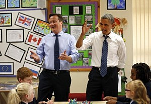 President Barack Obama, rear right, and British Prime Minister David Cameron, rear left, speak to students working on a school project about the G-8 summit during a visit to the Enniskillen Integrated Primary School