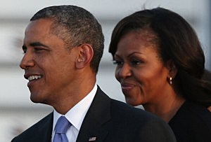 President Barack Obama and his wife Michelle descend from Air Force One upon their arrival at Berlin's Tegel airpor