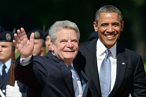 President Barack Obama (R) and German President Joachim Gauck wave to the media while arriving at Bellevue Palace in Berlin