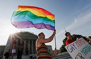 Gay rights supporter Vin Testa waves a rainbow flag outside the U.S. Supreme Court building