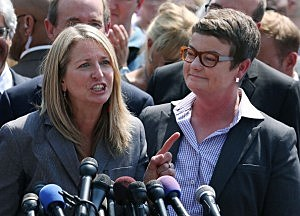 Plantiff couple Sandy Steier (L) and Kris Perry speak to the media after the U.S. Supreme Court ruled that part of the Defense of Marriage Act (DOMA) is unconstitutional