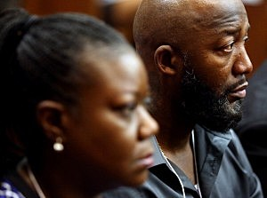 Trayvon Martin's parents Tracy Martin, right, and Sybrina Fulton listen while witness Rachel Jeantel gives her testimony