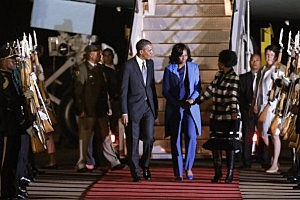 President Barack Obama (L) and first lady Michelle Obama (C) are greeted by Minister of International Relations and Cooperation Maite Mkoana-Mashabne after arriving at Waterkloof Air Force Base  in Pretoria, South Africa.