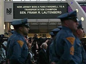New Jersey State Police stand at attention at the Lautenberg Train Station as the late Senator's body is sent to Washington