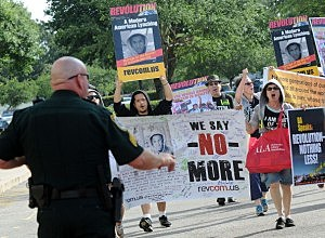 Revolutionary Communist Party members protest outside the Seminole County Courthouse during the first day of trail for George Zimmerman