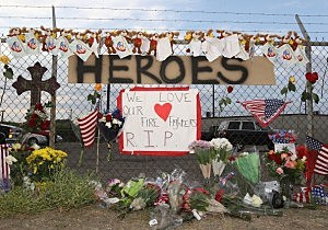 "A make shift memorial and a sign reading ""Heroes"" is displayed outside of Station 7  in Prescott, Arizona"