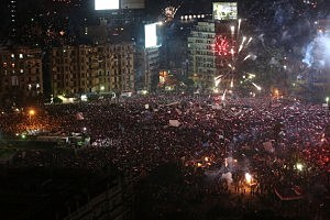 Fireworks and shouts of joy emanate from Tahrir Square after a broadcast by the head of the Egyptian military confirming that they will temporarily be taking over from the country's first democratically elected president Mohammed Morsi