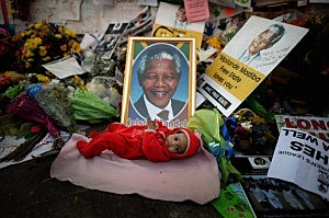 Oamohetaswe Mabitsela, 4 months old, lays in front of the tribute wall at the Mediclinic Heart Hospital where former South African President Nelson Mandela, 94, is being treated for a recurring lung infection