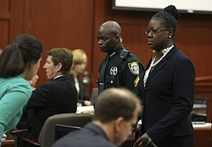 Sybrina Fulton, Trayvon Martin's mother, walks past the defense table after taking the stand during the George Zimmerman trial