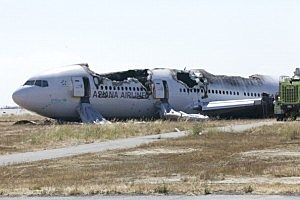The wreckage of Asiana Airlines flight 214 lies near the runway at San Francisco Airport