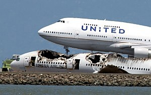 A United Airlines 747 lands next to the wreckage of Asiana Airlines flight 214