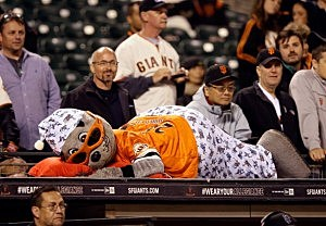 San Francisco Giants mascot Lou Seal watches the game in pajamas in the 15th inning against the New York Mets at AT&T Park