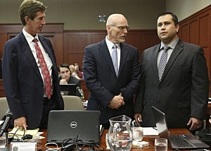 Standing next to his defense attorneys Mark O'Mara, (L), and Don West, (C), George Zimmerman addresses Judge Debra Nelson