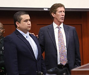 Defendant Defense attorney Mark O'Mara (R) has George Zimmerman stand in the courtroom for the jury during closing arguments