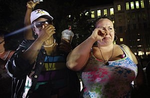 Kat Crowe (L) and Melinda O'Neal react in front of the Seminole County Criminal Justice Center after learning George Zimmerman had been found not guilty
