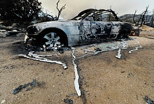 Liquified metal from a burned-out BMW next to destroyed home near Idyllwild, California