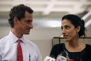 (L-R) Anthony Weiner and wife Huma Abedin