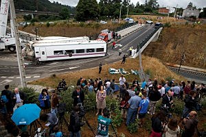 TV Journalists report from a vegetable plot near a train crash that killed at least 80 people  in Spain