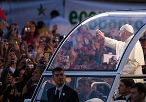 Pope Francis waves from the Popemobile on his way to attend the Via Crucis on Copacabana Beach during World Youth Day celebrations in Rio de Janeiro, Brazil.