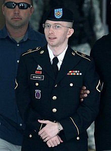 U.S. Army Private First Class Bradley Manning is escorted by military police