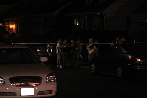 Attendees at a Hamilton Township party outside the home following a shooting