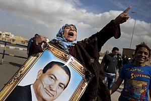 Supporters of the ousted Egyptian president Hosni Mubarak chant slogans and carry his portrait