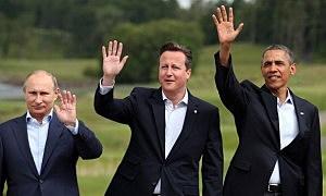 Leaders (L-R) Russia's President Vladimir Putin, Britain's Prime Minister David Cameron, US President Barack Obama
