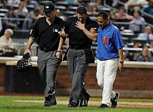 Homeplate umpire Manny Gonzalez