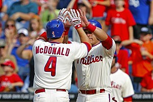 John McDonald of the Philadelphia Phillies is congratulated by Carlos Ruiz after hitting a two-run home run in the eighth inning during a game against the Chicago Cubs