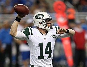 Greg McElroy #14 of the New York Jets rolls out to pass during the third quarter of the pre-season game against the Detroit Lions