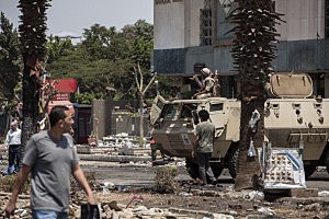 An Egyptian Military armoured vehicle is parked outside the Rabaa al-Adaweya Mosque in Nasr City