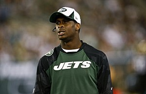 Geno Smith stands on the sidelines