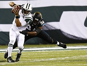 Jeremy Mincey  of the Jacksonville Jaguars sacks Mark Sanchez