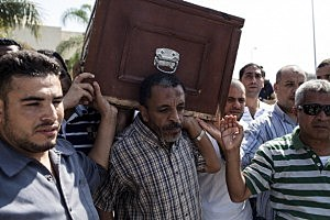 Pallbearers carry the coffin of Ammar Badie (38), son of the Muslim Brotherhood's Supreme Guide, Mohammed Badie during a funeral at the Hammad Mosque in the New Cairo district
