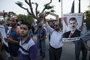 Supporters of deposed Egyptian President Mohammed Morsi gather on the Nile River corniche in the Maadi district to protest the recent killing of protesters by Egyptian Security Forces