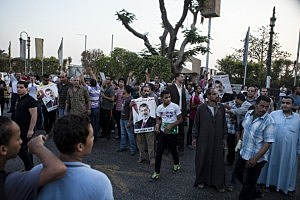 Supporters of deposed Egyptian President Mohammed Morsi gather on the Nile River corniche in the Maadi district