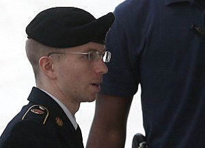 US Army Private First Class Bradley Manning is escorted by military police as he arrives for his sentencing at military court in Fort Meade, Maryland