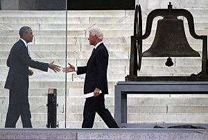 President Barack Obama (L) shakes hands with former U.S. President Bill Clinton during the ceremony to commemorate the 50th anniversary of the March on Washington for Jobs and Freedom