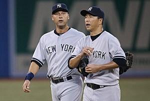 Hiroki Kuroda of the New York Yankees is consoled by Derek Jeter