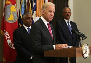 odd Jones (L) and Attorney General Eric Holder (R) listen to U.S. Vice President Joseph Biden during Jones' swearing in ceremony as the Director of the Bureau of Alcohol, Tobacco, and Firearms (ATF)