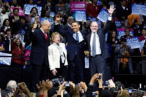 A 2009 New Jersey campaign rally with Cory Booker (L), U.S. Sen Loretta Weinberg (D-NJ) (2L), U.S. President Barack Obama (2R), and New Jersey Gov. Jon Corzine