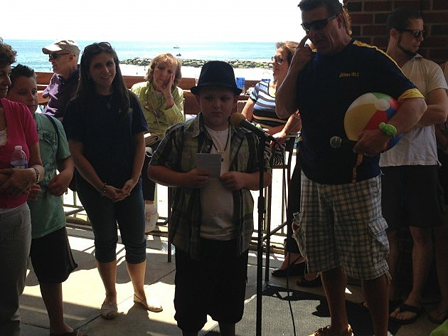 Young Comic entertains Dennis and Judi on the Asbury Park Boardwalk