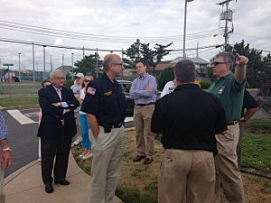 DOT Commissioner Jim Simpson with local officials on a tour of Normandy Beach.