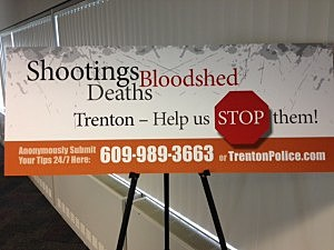 Sign asking for help in curbing gun violence in Trenton