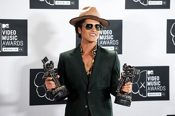 Bruno Mars poses with awards at the 2013 MTV Video Music Awards