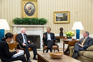 President Barack Obama (2R) meets with Senators John McCain and Lindsey Graham (R), and National Security Advisor Susan E. Rice (L) to discuss Syria in the Oval Office of the White House
