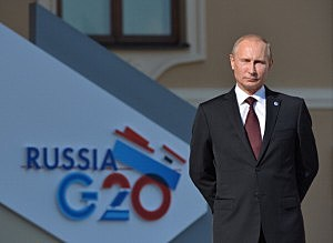 Russian President Vladimir Putin stands during an official welcome of G20 heads of state and government