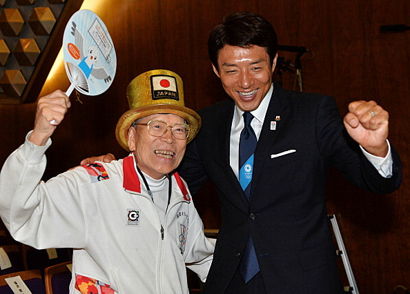 Naotoshi Yamada (L) and Shuzo Matsuoka (R) cheer in support of Tokyo's bid for the 2020 Summer Olympic Games,