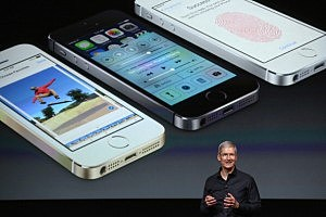 Apple CEO Tim Cook speaks about the new iPhone during an Apple product announcement at the Apple campus in Cupertino, California